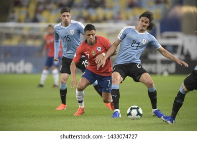 RIO DE JANEIRO, BRAZIL - June 24, 2019: Rojas Vargas  of Chile and Cavani  of Uruguay compete for the ball during the 2019 Copa America Group C game between Chile and Uruguay at Maracana Stadium.