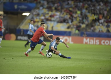 RIO DE JANEIRO, BRAZIL - June 24, 2019: De Arrascaeta  of Uruguay kicks the ball during the 2019 Copa America Group C game between Chile and Uruguay at Maracana Stadium.