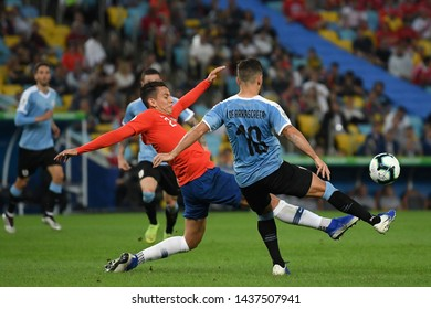 Rio de Janeiro, Brazil, June 24, 2019. Soccer players compete for the ball during the Chile vs Uruguay game for the Copa America 2019 at the Maracanã stadium.