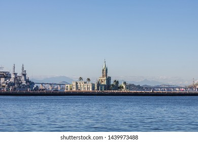 Rio de Janeiro, Brazil -June 07, 2019: The historical building and Fiscal Island (Ilha Fiscal) in the Guanabara bay attached to the naval island with military ship in the background