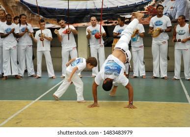 Rio de Janeiro, Brazil, June 24, 2019 Boy playing capoeira in a school block in the west side of the city of Rio de Janeiro.