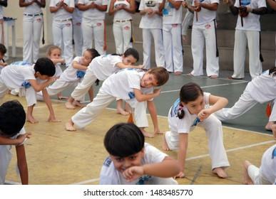 Rio de Janeiro, Brazil, June 24, 2019 Kids playing capoeira in a school block on the west side of Rio de Janeiro city.