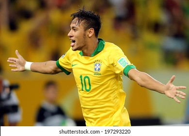 RIO DE JANEIRO, BRAZIL - June 6, 2013: Brazil's forward Neymar celebrates after scoring a goal against Spain during the final Confederations Cup soccer match at Maracana Stadium. No Use In Brazil.