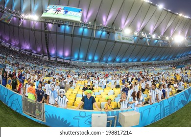 RIO DE JANEIRO, BRAZIL - June 15, 2014: Soccer fans celebrating at the 2014 World Cup Group F game between Argentina and Bosnia at Maracana Stadium. No Use in Brazil