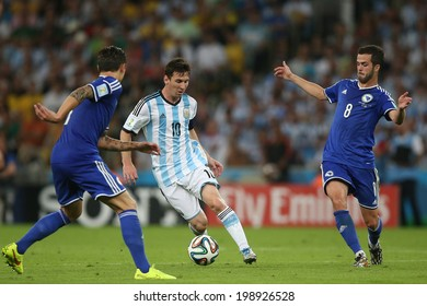 RIO DE JANEIRO, BRAZIL - June 15, 2014: MESSI of Argentina and PjANIC of Bosnia compete for the ball during the World Cup Group F game between Argentina and Bosnia at Maracana Stadium. No Use in Brazil.