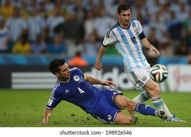 RIO DE JANEIRO, BRAZIL - June 15, 2014: MESSI of Argentina and PAHIC of Bosnia compete for the ball during the World Cup Group F game between Argentina and Bosnia at Maracana Stadium. No Use in Brazil.