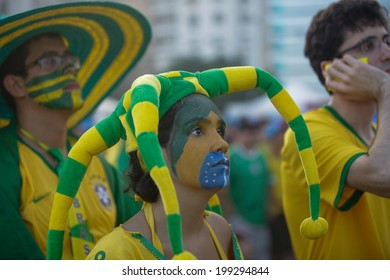 RIO DE JANEIRO, BRAZIL - June 17, 2014: Fans are seen as they watch the World Cup Group A game between Brazil and Mexico on outdoor screens on the Copacabana beach. No Use in Brazil.