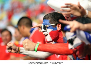 RIO DE JANEIRO, BRAZIL - June 18, 2014: Soccer fans celebrating at the 2014 World Cup Group B game between Spain and Chile at Maracana Stadium. No Use in Brazil.