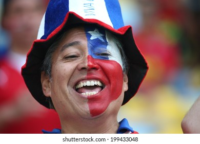 RIO DE JANEIRO, BRAZIL - June 18, 2014: Chilean soccer fans celebrates at the 2014 World Cup Group B game between Spain and Chile at Maracana Stadium. No Use in Brazil