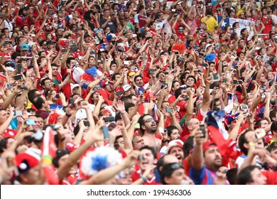 RIO DE JANEIRO, BRAZIL - June 18, 2014: Chilean soccer fans celebrating at the 2014 World Cup Group B game between Spain and Chile at Maracana Stadium. No Use in Brazil
