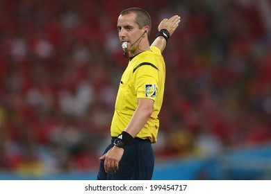 RIO DE JANEIRO, BRAZIL - June 18, 2014: Head referee Mark Geiger during the World Cup Group B game between Spain and Chile at Maracana Stadium. NO USE IN BRAZIL