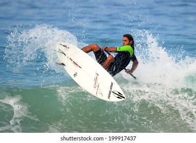 Rio de Janeiro, Brazil, June 20, 2014 athletes do stand up paddle training on Ipanema beach