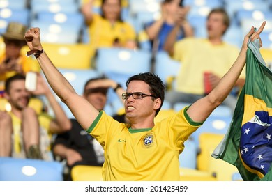 RIO DE JANEIRO, BRAZIL - June 28, 2014: Soccer fans celebrating at the 2014 World Cup Round of 16 game between Colombia and Uruguay at Maracana Stadium.