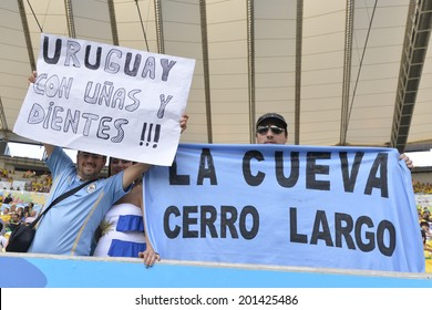 RIO DE JANEIRO, BRAZIL - June 28, 2014: Uruguay soccer fans celebrating at the 2014 World Cup Round of 16 game between Colombia and Uruguay at Maracana Stadium.