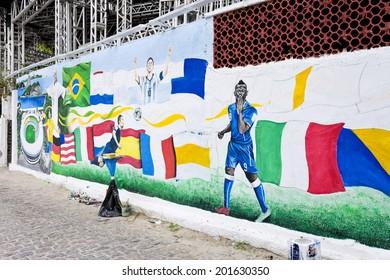 RIO DE JANEIRO, BRAZIL - June 23, 2014 panel on World Cup in Brazil - artist painting Jambeiro - Copacabana Beach