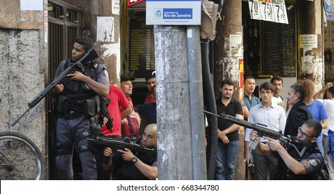 Rio de Janeiro, Brazil  June 29th, 2017- Policemen secures a street  at  Pavao Pavaozinho shantytown in Copacabana during a clash with druglords