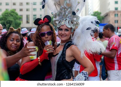 Rio de Janeiro, Brazil - March 3, 2014: People having a good time and posing in festive costumes at a carnival block party in the city centre of Rio de Janeiro