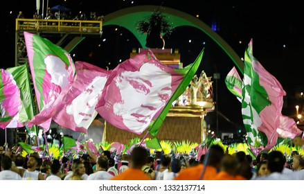 Rio de Janeiro, Brazil    March 06, 2019  Carnival  Mangueira samba school parades waving flags with poor and black people martyr as Marielle Franco(C)  a politician woman