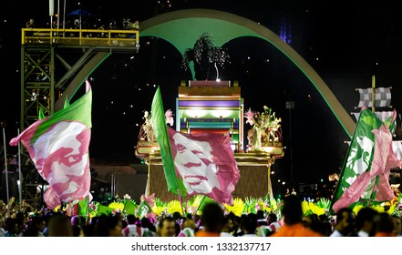 Rio de Janeiro, Brazil    March 06, 2019  Carnival  Mangueira samba school parades waving flags with poor and black people martyrs as Marielle Franco(C)  a politician woman