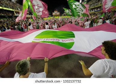 Rio de Janeiro, Brazil    March 06, 2019  Carnival  Mangueira samba school parades waving flags with poor and black people martyrs as Marielle Franco a politician woman murdered on 2018