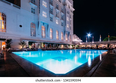 Rio de Janeiro, Brazil, March 17, 2019: Poolside bar and lounge chairs at luxurious Copacabana Palace Belmond in Copacabana, Rio de Janeiro, Brazil