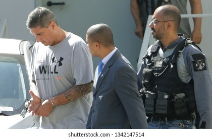 Rio de Janeiro, Brazil - March 15, 2019: Ronnie Lessa  (L, grey t-shirt) accused of killing in an outrage the human rights defender and politician Marielle Franco arrives to the jail.