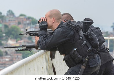 RIO DE JANEIRO. BRAZIL, MARCH, 21, 2015 - Rio de Janeiro military police patrolling the slum complex of the German's heavily armed and armored vehicle complex