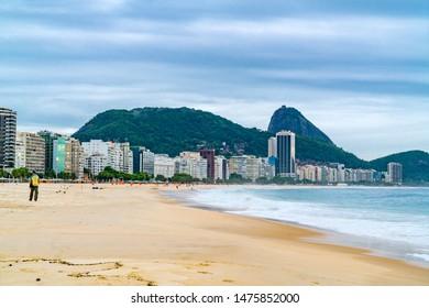 RIO DE JANEIRO, BRAZIL - MARCH 2, 1916 : View of Copacabana Beach in Rio de Janeiro in the evening