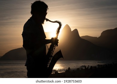 Rio de Janeiro, Rio de Janeiro, Brazil - March 03, 2020: Silhouette of a musician playing in Ipanema