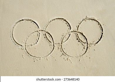 RIO DE JANEIRO, BRAZIL - MARCH 20, 2015: Olympic rings drawn in the sand on Ipanema Beach in anticipation of the city hosting the 2016 Summer Games.