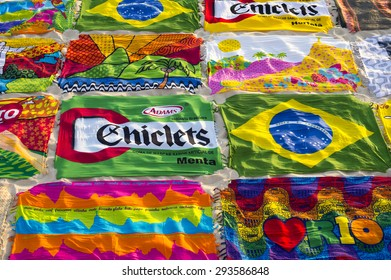 RIO DE JANEIRO, BRAZIL - MARCH 15, 2015: Beach blanket sarongs known locally as canga spread out in colorful display along the Ipanema Beach boardwalk.
