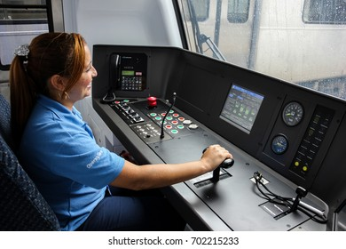 Rio de Janeiro, Brazil, March 21, 2015: Urban trains connects several cities of metropolitan region of the State of Rio. In this image, woman in the cockpit of an urban train of Rio de Janeiro.