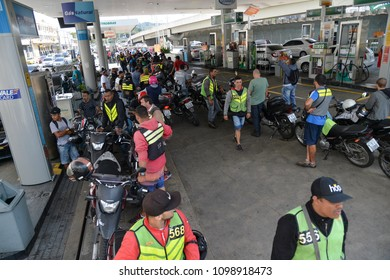 Rio de Janeiro, Brazil - may 25, 2018:  Because of the truck drivers' strike the city faces lack of fuel. The drivers queue to fill the tank at the gas stations