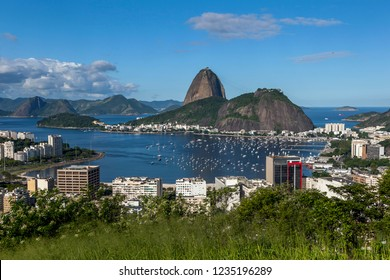 RIO DE JANEIRO, BRAZIL - MAY 08, 2012 : An afternoon view in Rio de Janeiro in Brazil looking towards Sugarloaf Mountain which sits in Guanabara Bay on the Atlantic Ocean.