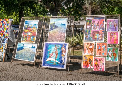 Rio de Janeiro, Brazil - May 12, 2019:  Art displayed at the outdoor Hippie Fair market in General Osorio Plaza in Ipanema. - Image