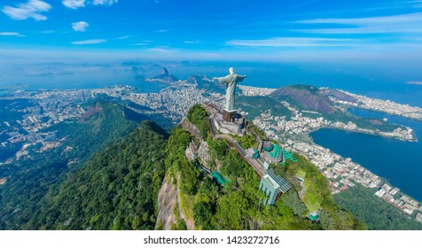RIO DE JANEIRO, Brazil, May 20, 2019: Christ Redeemer and Corcovado Mountain, view from the bird's-eye view. Extremely beautiful Rio de Janeiro, Brazil . Panoramic aerial photography .