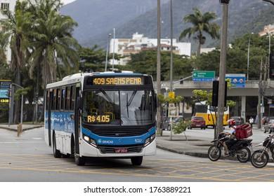RIO DE JANEIRO, BRAZIL - May 27, 2020: Rio de Janeiro, Brazil - May 27, 2020: Traffic and local bus in Jardim Botanico neighbourhood