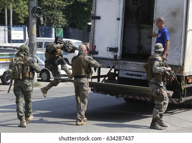 RIO DE JANEIRO, Brazil May, 04th, 2017  Anti-riot policemen searches a truck looking for drugs at the Alemao shatytown entrance after a confrontation with drug lords that resulted in 5 deaths.
