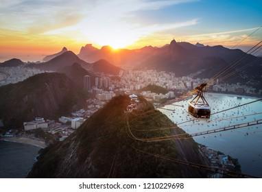 Rio de Janeiro, Brazil - Nov 2, 2017: Aerial view of Rio de Janeiro at sunset with Urca and Sugar Loaf Cable Car and Corcovado mountain  - Rio de Janeiro, Brazil