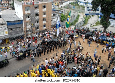 Rio de Janeiro, Brazil, November 13, 2011. Brazilian flag is hoisted by the military police during the occupation of the favela community of Rocinha in the operation Shock of Peace