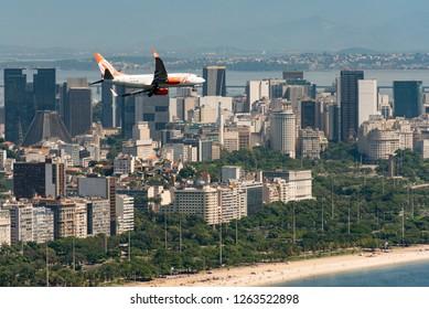 Rio de Janeiro, Brazil - November 23, 2018: Gol airlines aircraft is flying above Rio de Janeiro city. Gol is Brazilian low cost carrier.