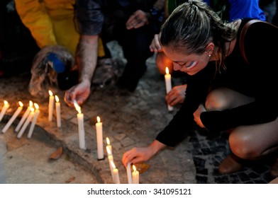 Rio de Janeiro, Brazil - November 15, 2015 - A girl with a French flag painted on her face participates in a vigil in honor of people killed in the Paris attacks.