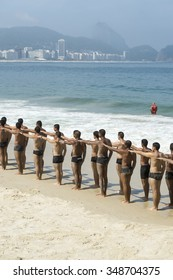 RIO DE JANEIRO, BRAZIL - NOVEMBER 10, 2015: Lifeguards take part in a training course for the city's Guarda-Vidas (lifeguards) force, part of the fire department, on Copacabana Beach.