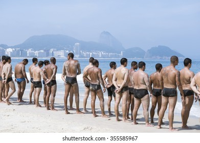 RIO DE JANEIRO, BRAZIL - NOVEMBER 10, 2015: Lifeguards take part in a training course for the city's Guarda-Vidas (lifeguards) force, part of the bombeiros fire department, on Copacabana Beach.