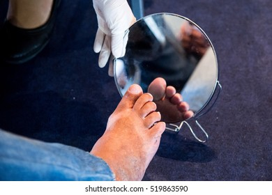 Rio de Janeiro, Brazil - november 14, 2016:  Health professional teaches patient to look at foot, for diabetic foot detection during World Diabetes Day event