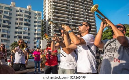 RIO DE JANEIRO, BRAZIL - NOVEMBER 27, 2016: Music band playing trombones and saxophone in the street at Festival Fanfare Activist (Festival de Fanfarras Ativistas - HONK! RiO 2016) near Leme district