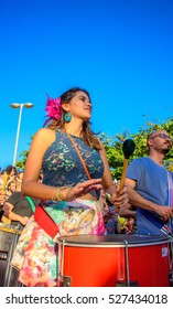 RIO DE JANEIRO, BRAZIL - NOVEMBER 27, 2016: Beautiful woman playing batucada in the street at sunny day at Festival Fanfare Activist Festival de Fanfarras Ativistas - HONK RiO 2016 at Leme district