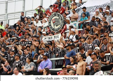 RIO DE JANEIRO, BRAZIL - NOVEMBER 19, 2017: Fans of Sport Club Corinthians Paulista during the Brazilian Football Championship game between Flamengo and the Corinthians in the Estadio Ilha do Urubu.