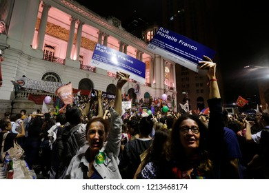 RIO DE JANEIRO, Brazil October 27th, 2018 - teatchers aves a banner  with the name of murdered councilwoman Marielle during a demonstration against facism in the main square Cinelandia