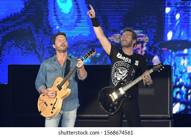 Rio de Janeiro, Brazil, October 6, 2019. Guitarists Chad Kroeger and Ryan Peake of Canadian rock band Nickelback during a concert at Rock in Rio 2019 in Rio de Janeiro.